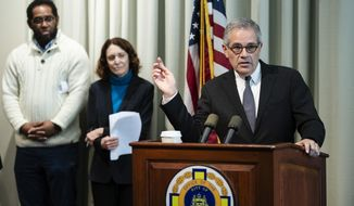 """Philadelphia District Attorney Larry Krasner, right, accompanied by artist James """"Yaya"""" Hough and Mural Arts Philadelphia Executive Director Jane Golden, speaks during a news conference in Philadelphia, Thursday, Nov. 21, 2019. Hough who was sent to prison for life as a 17-year-old has been chosen for a Mural Arts Philadelphia residency and will design a public mural that addresses mass incarceration. He is among the """"juvenile lifers"""" released since the U.S. Supreme Court banned mandatory life sentences for minors. (AP Photo/Matt Rourke)"""