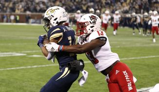 Georgia Tech wide receiver Ahmarean Brown makes a catch for a touchdown as North Carolina State linebacker Tyler Baker-Williams (13) defends during the first half of an NCAA college football game Thursday, Nov. 21, 2019, in Atlanta. (AP Photo/John Bazemore)