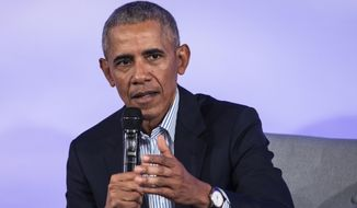 In a Tuesday, Oct. 29, 2019 file photo, former President Barack Obama speaks during the Obama Foundation Summit at the Illinois Institute of Technology in Chicago. Former President Barack Obama says addressing global economic inequality is key to fighting climate change. Obama spoke  Wednesday, Nov. 20, 2019 at the sustainable building conference Greenbuild in Atlanta.(Ashlee Rezin Garcia/Chicago Sun-Times via AP, File)