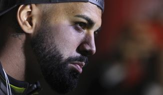 Gabriel Barbosa of Brazil's Flamengo talks to the press after arriving at the military airport Grupo Aereo 8, in Lima, Peru, Wednesday, Nov. 20, 2019. The team will play Argentina's River Plate on Saturday's Copa Libertadores final. (AP Photo/Martin Mejia)