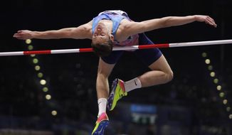 FILE - In this file photo dated Thursday, March 1, 2018, Russia's Danil Lysenko makes an attempt in the men's high jump final at the World Athletics Indoor Championships in Birmingham, England.  The president of Russia's track and field federation Dmitry Shlyakhtin was suspended Thursday Nov. 21, 2019, on suspicion of obstructing an anti-doping investigation related to Lysenko, who allegedly presented fake medical records. (AP Photo/Matt Dunham, FILE)