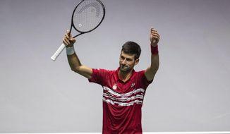 Serbia's Novak Djokovic celebrates his victory over France's Benoit Paire during their Davis Cup tennis match in Madrid, Spain, Thursday, Nov. 21, 2019. (AP Photo/Bernat Armangue)