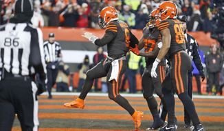 Cleveland Browns quarterback Baker Mayfield (6) celebrates after scoring a 1-yard touchdown during the first half of the team's NFL football game against the Pittsburgh Steelers, Thursday, Nov. 14, 2019, in Cleveland. (AP Photo/Ron Schwane)