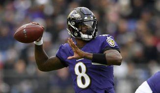 Baltimore Ravens quarterback Lamar Jackson throws a pass against the Houston Texans prior to an NFL football game, Sunday, Nov. 17, 2019, in Baltimore. (AP Photo/Nick Wass) ** FILE **