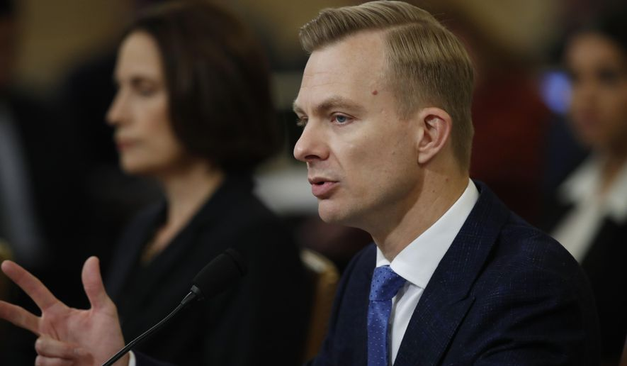 David Holmes, a U.S. diplomat in Ukraine, right, testifies before the House Intelligence Committee on Capitol Hill in Washington, Thursday, Nov. 21, 2019, during a public impeachment hearing of President Donald Trump's efforts to tie U.S. aid for Ukraine to investigations of his political opponents. Former White House national security aide Fiona Hill, is left. (AP Photo/Alex Brandon)
