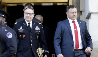 National Security Council aide Lt. Col. Alexander Vindman, left, walks with his twin brother, Army Lt. Col. Yevgeny Vindman, after testifying before the House Intelligence Committee on Capitol Hill in Washington, Tuesday, Nov. 19, 2019, during a public impeachment hearing of President Donald Trump's efforts to tie U.S. aid for Ukraine to investigations of his political opponents. (AP Photo/Julio Cortez) ** FILE **