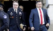 National Security Council aide Lt. Col. Alexander Vindman, left, walks with his twin brother, Army Lt. Col. Yevgeny Vindman, after testifying before the House Intelligence Committee on Capitol Hill in Washington, Tuesday, Nov. 19, 2019, during a public impeachment hearing of President Donald Trump's efforts to tie U.S. aid for Ukraine to investigations of his political opponents. (AP Photo/Julio Cortez)