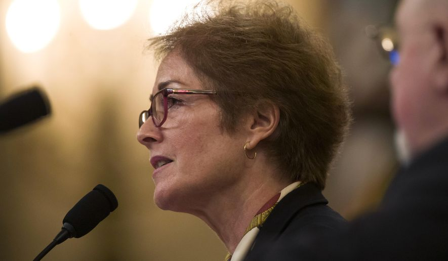 Former U.S. Ambassador to Ukraine Marie Yovanovitch testifies before the House Intelligence Committee on Capitol Hill in Washington, Friday, Nov. 15, 2019, during the second public impeachment hearing of President Donald Trump's efforts to tie U.S. aid for Ukraine to investigations of his political opponents. (AP Photo/Alex Brandon) **FILE**