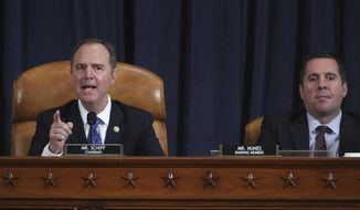 House Intelligence Committee Chairman Adam Schiff, D-Calif., left, with Rep. Devin Nunes, R-Calif, the ranking member, concludes a day of testimony by key witnesses as it probes President Donald Trump's efforts to tie U.S. aid for Ukraine to investigations of his political opponents, on Capitol Hill in Washington, Wednesday, Nov. 20, 2019. (Jonathan Ernst/Pool Photo via AP)