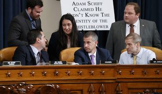 Rep. Devin Nunes, R-Calif, the ranking member of the House Intelligence Committee, left, confers with Steve Castor, the Republican staff attorney, lower center, and Rep. Jim Jordan, R-Ohio, lower right, and other staff aides, after Deputy Assistant Secretary of Defense Laura Cooper, and State Department official David Hale, testified before the House Intelligence Committee on Capitol Hill in Washington, Wednesday, Nov. 20, 2019, during a public impeachment hearing of President Donald Trump's efforts to tie U.S. aid for Ukraine to investigations of his political opponents. (AP Photo/Alex Brandon)