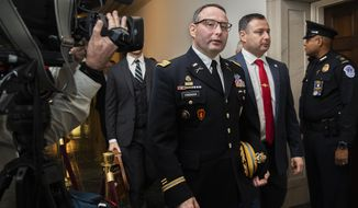 National Security Council aide Lt. Col. Alexander Vindman, left, leaves Capitol Hill as they conclude a public impeachment hearing of President Donald Trump's efforts to tie U.S. aid for Ukraine to investigations of his political opponents, in Washington, Tuesday, Nov. 19, 2019. (AP Photo/Manuel Balce Ceneta)