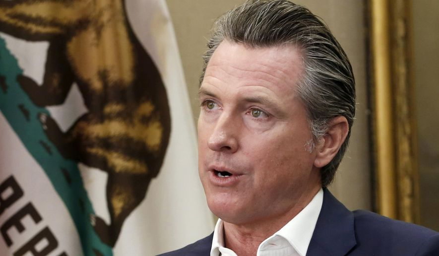 This Oct. 8, 2019, file photo, shows California Gov. Gavin Newsom during an interview in his office at the Capitol in Sacramento, Calif. California's Supreme Court rejected a state law that would have required President Donald Trump to disclose his tax returns to appear as a candidate in the state's primary election next spring. The justices on Thursday, Nov. 21, 2019 said the law that would have required tax returns for all presidential and gubernatorial candidates to appear on the primary ballot was unconstitutional. The state Republican Party challenged the bill signed into law by Newsom because it was aimed at Trump. (AP Photo/Rich Pedroncelli, File)