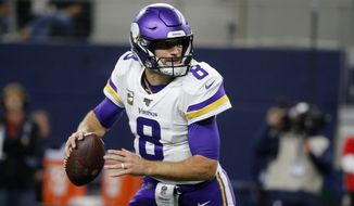 Minnesota Vikings quarterback Kirk Cousins (8) scrambles out of the pocket before throwing a pass during the first half of the team's NFL football game against the Dallas Cowboys in Arlington, Texas, Sunday, Nov. 10, 2019. (AP Photo/Michael Ainsworth) ** FILE **
