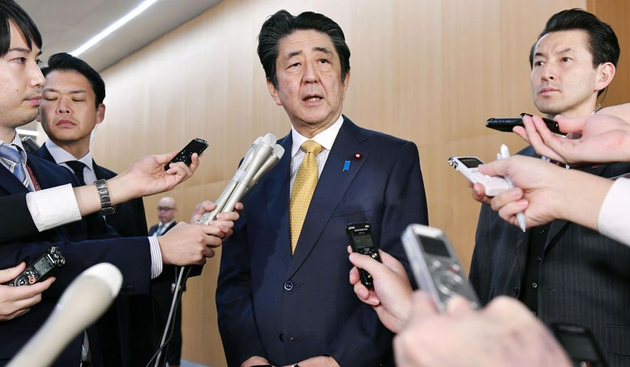 Japanese Prime Minister Shinzo Abe speaks to reporters following South Korea's announcement on a military intelligence-sharing agreement at his official residence in Tokyo Friday, Nov. 22, 2019. In a major policy reversal, South Korea said Friday it has decided to continue the 2016 military intelligence-sharing agreement with Japan that it previously said it would terminate amid ongoing tensions over wartime history and trade. The announcement was made just six hours before the General Security of Military Intelligence Agreement, or GSOMIA, was to expire. (Yoshitaka Sugawara/Kyodo News via AP)