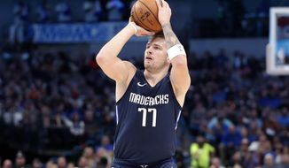 Dallas Mavericks forward Luka Doncic (77) attempts a three-pint basket in the first half of an NBA basketball game against the Cleveland Cavaliers in Dallas, Friday, Nov. 22, 2019. (AP Photo/Tony Gutierrez)