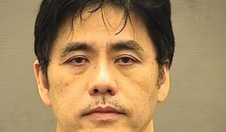 This undated file photo provided by the Alexandria Sheriff's Office shows Jerry Chun Shing Lee. The former CIA officer who pleaded guilty to an espionage conspiracy with China could be facing more than two decades in prison. Fifty-five-year-old Lee is scheduled for sentencing Friday, Nov. 22, 2019, in federal court in Alexandria, Va. (Alexandria Sheriff's Office via AP, File)
