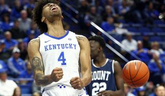 Kentucky's Nick Richards (4) reacts after a shot near Mount St. Mary's Nana Opoku (22) during the first half of an NCAA college basketball game in Lexington, Ky., Friday, Nov. 22, 2019. (AP Photo/James Crisp)