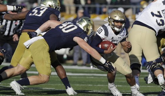 Navy quarterback Malcolm Perry (10) is tackled by Notre Dame linebacker Drew White (40) during the first half of an NCAA college football game, Saturday, Nov. 16, 2019, in South Bend, Ind. (AP Photo/Darron Cummings) ** FILE **
