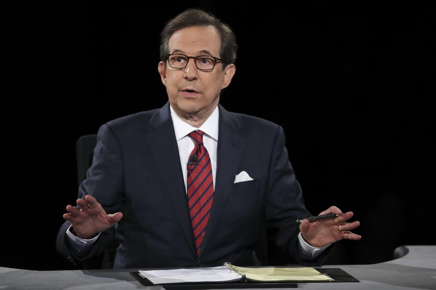 In this Oct. 19, 2016, file photo, moderator Chris Wallace guides the discussion between Democratic presidential nominee Hillary Clinton and Republican presidential nominee Donald Trump during the third presidential debate at UNLV in Las Vegas. (Joe Raedle/Pool via AP, File)