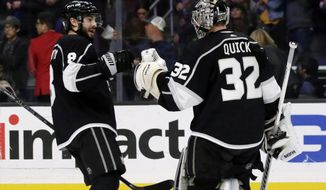 Los Angeles Kings defenseman Drew Doughty, left, congratulates goaltender Jonathan Quick after the Kings defeated the Edmonton Oilers 5-1 in an NHL hockey game in Los Angeles, Thursday, Nov. 21, 2019. (AP Photo/Alex Gallardo)