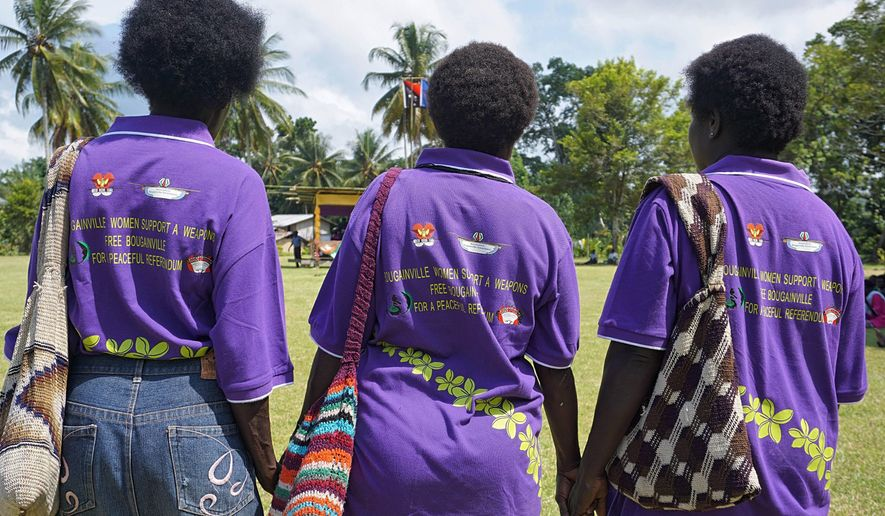 In this April 2018, photo released by United Nations Development Programme, women in the village of Aero, Central Bougainville, come together for a unification ceremony. The Pacific people of Bougainville will on Saturday, Nov. 23, 2019, begin voting in a historic referendum to decide if they want to become the world's newest nation by gaining independence from Papua New Guinea. The referendum will run over two weeks and is a key part of a 2001 peace agreement that ended a brutal civil war in at least 15,000 people died in the cluster of islands to the east of the Papua New Guinea mainland. (Nick Turner/UNDP via AP)