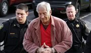 In this Oct. 29, 2015, file photo Former Penn State University assistant football coach Jerry Sandusky, center, arrives at the Centre County Courthouse for a hearing about his appeal on his child sex-abuse conviction, in Bellefonte, Pa. Sandusky is expected in a Pennsylvania courtroom Friday, Nov. 22, 2019, to be resentenced after an appeals court said mandatory minimum sentences had been improperly applied against him. (AP Photo/Gene J. Puskar, File)