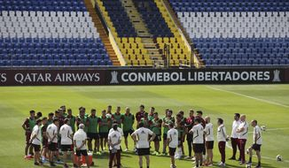 Players of Argentina's River Plate's listen to coach Marcleo Gallardo during a practice session at the Alianza Lima's Club in Lima, Peru, Thursday, Nov. 21, 2019. River Plate will play against Brazil's Flamengo on Saturday in the Copa Libertadores final match. (AP Photo/Martin Mejia)