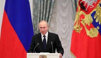 Russian President Vladimir Putin delivers his speech at the State Awards ceremony in the Kremlin in Moscow, Russia, Thursday, Nov. 21, 2019. (Alexei Druzhinin, Sputnik, Kremlin Pool Photo via AP)