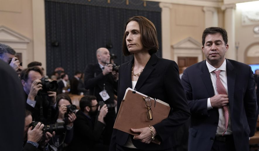 Former White House national security aide Fiona Hill, joined by her attorney Lee Wolosky, right, departs after testifying before the House Intelligence Committee on Capitol Hill in Washington, Thursday, Nov. 21, 2019, during a public impeachment hearing of President Donald Trump's efforts to tie U.S. aid for Ukraine to investigations of his political opponents. (AP Photo/J. Scott Applewhite)