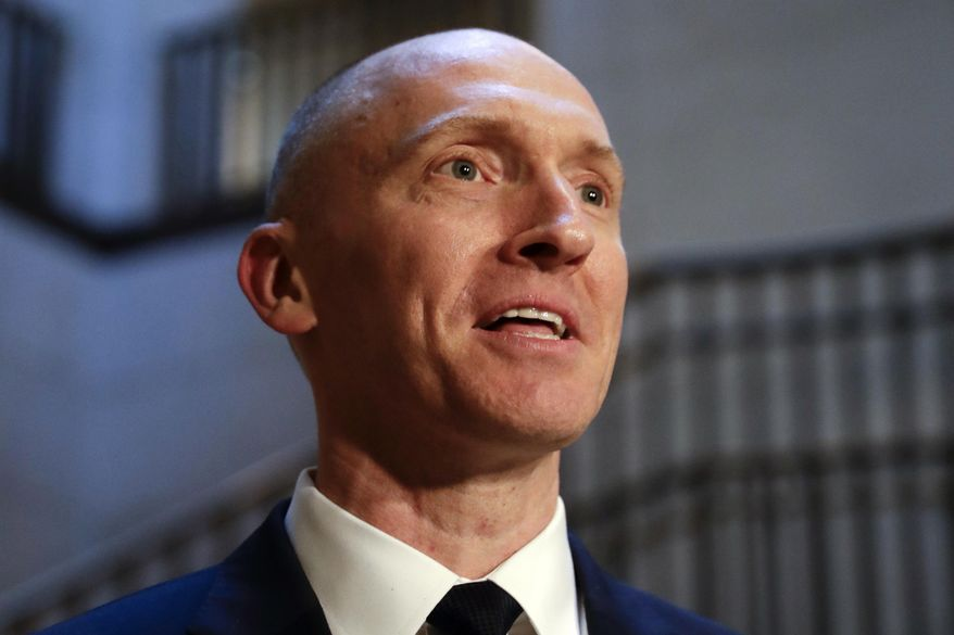 In this Nov. 2, 2017, photo, Carter Page, a foreign policy adviser to Donald Trump's 2016 presidential campaign, speaks with reporters following a day of questions from the House Intelligence Committee, on Capitol Hill in Washington. (AP Photo/J. Scott Applewhite) ** FILE **