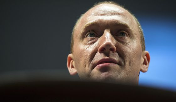 Carter Page, an adviser to U.S. Republican presidential candidate Donald Trump, speaks at the graduation ceremony for the New Economic School in Moscow, Russia.    (AP Photo/Pavel Golovkin)