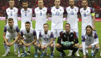 Players of Iceland team pose for a group photo before the Euro 2020 Group H qualifying soccer match between Turkey and Iceland in Istanbul, Thursday, Nov. 14, 2019. (AP Photo)