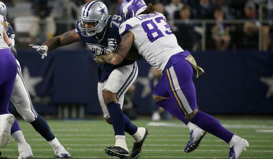 Dallas Cowboys defensive lineman Michael Bennett (79) rushes as Minnesota Vikings tight end Tyler Conklin (83) blocks during the second half of an NFL football game in Arlington, Texas, Sunday, Nov. 10, 2019. (AP Photo/Ron Jenkins)