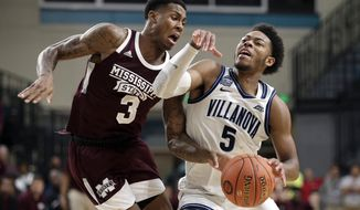 Mississippi State guard D.J. Stewart Jr. (3) guards Villanova guard Justin Moore (5) during the second half of an NCAA college basketball game at the Myrtle Beach Invitational in Conway, S.C., Friday, Nov. 22, 2019. (AP Photo/Gerry Broome)