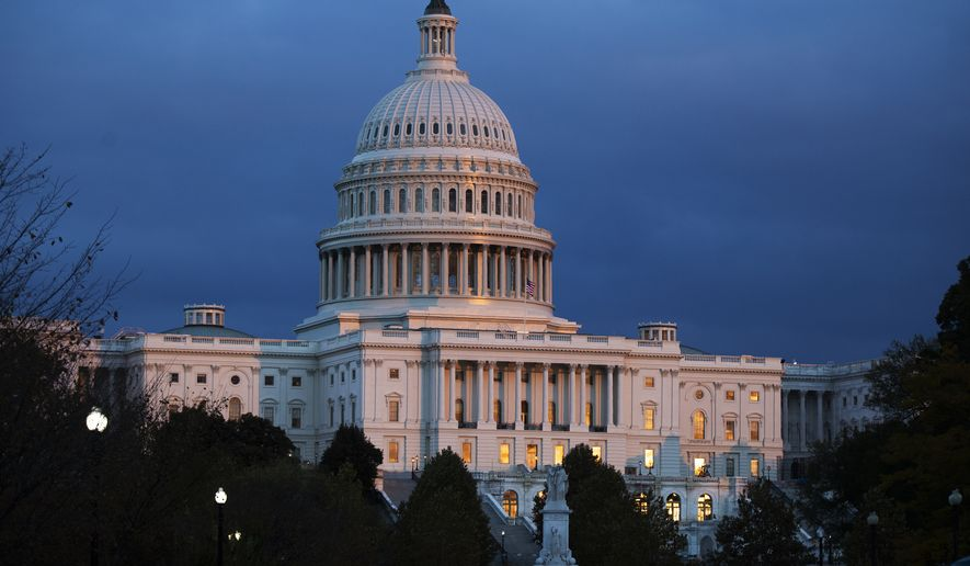 In this Tuesday, Nov. 12, 2019, file photo, the U.S. Capitol is seen as the sun sets in Washington. Negotiations on a package of spending bills to fund the federal government have produced a key breakthrough, though considerably more work is needed to wrap up the long-delayed measures. Top lawmakers of the House and Senate Appropriations committees on Saturday, Nov. 23, confirmed agreement on allocations for each of the 12 spending bills. (AP Photo/Manuel Balce Ceneta, File) **FILE**