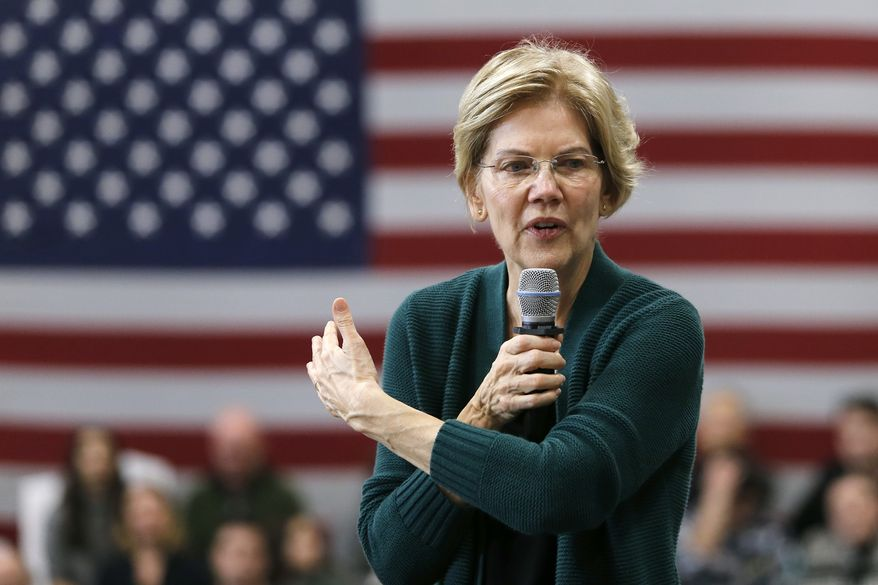 Democratic presidential candidate Sen. Elizabeth Warren, D-Mass., gestures as she speaks during a campaign stop, Saturday, Nov. 23, 2019, in Manchester, N.H. (AP Photo/Mary Schwalm)