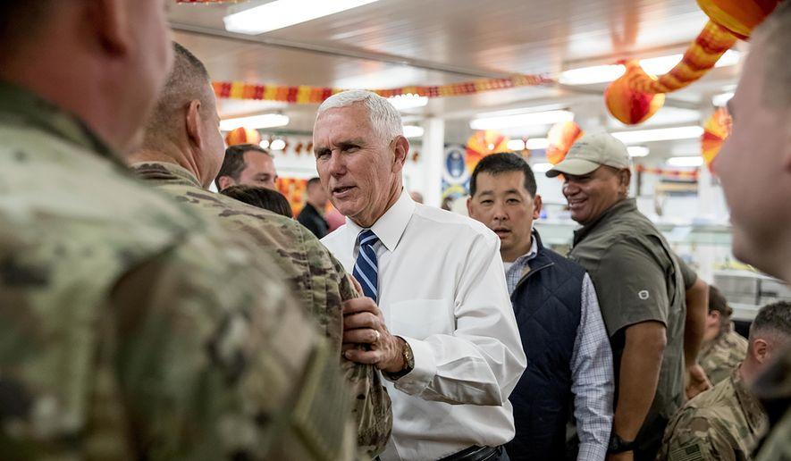 Vice President Mike Pence greets troops at a mess hall at Al Asad Air Base, Iraq, Saturday, Nov. 23, 2019. (AP Photo/Andrew Harnik)