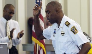 """In this July 20, 2007 photo, Lowndes County Chief Deputy John Williams speaks during the memorial service for Lowndes County Sheriff Willie Vaughner at the Lowndes County Courthouse in Hayneville, Ala. Alabama Gov. Kay Ivey says Lowndes County Sheriff Williams has been fatally shot in the line of duty. Ivey said Williams was """"tragically killed"""" Saturday evening, Nov. 23, 2019. (Mickey Welsh/Montgomery Advertiser via AP)"""