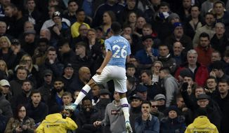 Manchester City's Riyad Mahrez celebrates after scoring his side's second goal during the English Premier League soccer match between Manchester City and Chelsea at Etihad stadium in Manchester, England, Saturday, Nov. 23, 2019. (AP Photo/Rui Vieira)