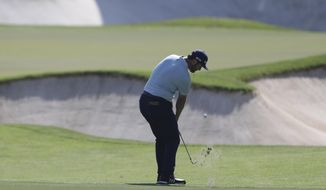 Jon Rahm of Spain plays a shot on the 2nd hole during the third round of the DP World Tour Championship golf tournament in Dubai, United Arab Emirates, Saturday, Nov. 23, 2019. (AP Photo/Kamran Jebreili)