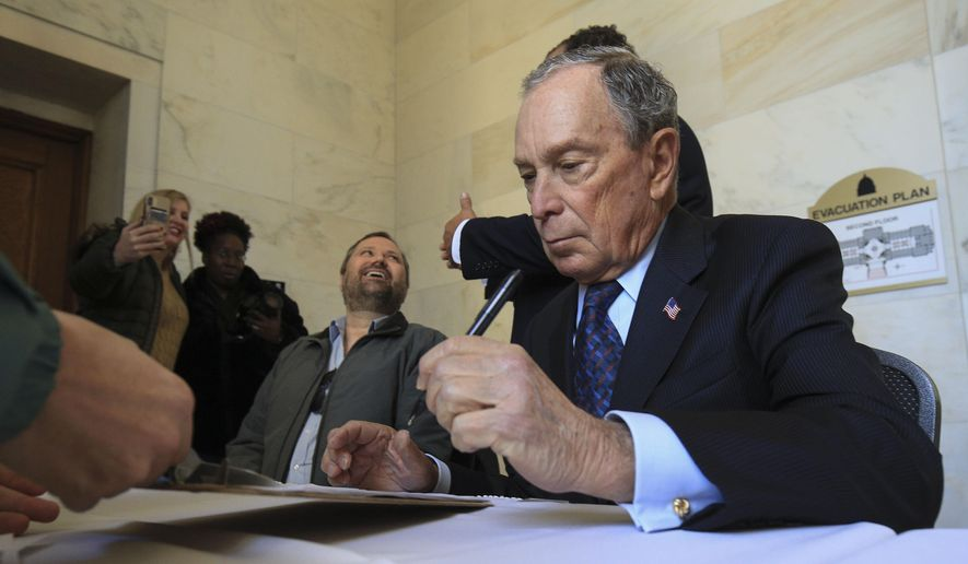 Former New York City Mayor Michael Bloomberg fills out paperwork, Tuesday, Nov. 12, 2019, at the state Capitol in Little Rock, Ark., to appear on the ballot in Arkansas' March 3 presidential primary. Bloomberg hasn't formally announced a bid for the Democratic presidential nomination, but his trip to Arkansas is the latest indication that he is leaning toward a run. (Staton Breidenthal/The Arkansas Democrat-Gazette via AP) **FILE**