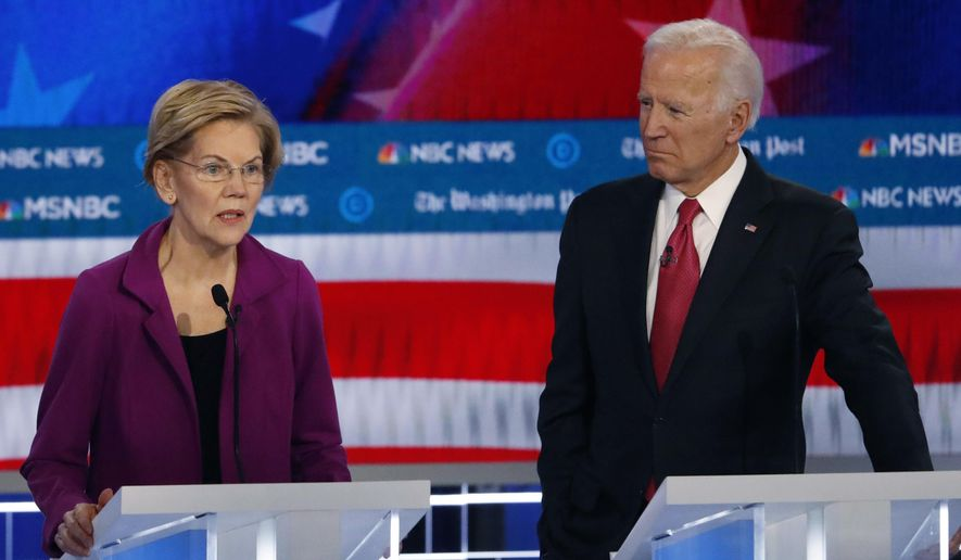 Democratic presidential candidate Sen. Elizabeth Warren, D-Mass., speaks as Democratic presidential candidate former Vice President Joe Biden listens during a Democratic presidential primary debate, Wednesday, Nov. 20, 2019, in Atlanta. (AP Photo/John Bazemore) ** FILE **