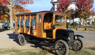 Ted Hawk and his nephew, Mark Runk, are building a 1925 Ford Model TT hearse to take Hawk's brother home to the family cemetery after he dies. The hearse sits in front of Hawk's Victorian house on Oct. 24, 2019, in East Rochester, Ohio. (Rachel Wagoner/Farm and Dairy via AP)