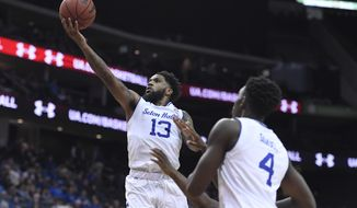 Seton Hall guard Myles Powell (13) makes a layup during the second half of an NCAA college basketball game against Florida A&M, Saturday, Nov. 23, 2019 in Newark, N.J. (AP Photo/Sarah Stier)