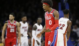 Philadelphia 76ers' Josh Richardson (0) reacts after a basket during the first half of an NBA basketball game against the Miami Heat, Saturday, Nov. 23, 2019, in Philadelphia. (AP Photo/Matt Slocum)