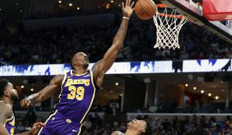 Los Angeles Lakers' Dwight Howard goes up for a rebound in the first half of a NBA basketball game against the Memphis Grizzlies' Saturday, Nov. 23, 2019, in Memphis, Tenn. (AP Photo/Karen Pulfer Focht)