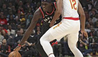 Toronto Raptors' Pascal Siakam (43) tries to drive around Atlanta Hawks' De'Andre Hunter during the second half of an NBA basketball game Saturday, Nov. 23, 2019, in Atlanta. (AP Photo/Tami Chappell)