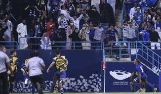 Al Hilal's Andre Diaz, right, celebrates after scoring his side's opening goal during the first leg of the AFC Champions League final soccer match between Al Hilal and Urawa Red at King Fahd stadium in Riyadh, Saudi Arabia, Saturday, Nov. 9, 2019. Al Hilal won 1-0. (AP Photo)