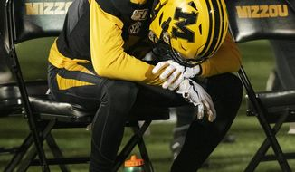Missouri wide receiver Kam Scott sits alone on the bench in the final seconds of their 24-20 loss to Tennessee in an NCAA college football game, Saturday, Nov. 23, 2019, in Columbia, Mo. (AP Photo/L.G. Patterson)