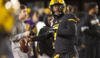 Missouri quarterback Kelly Bryant warms up before an NCAA college football game against Tennessee, Saturday, Nov. 23, 2019, in Columbia, Mo. (AP Photo/L.G. Patterson)